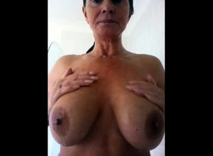 Big-titted grandma taking a shower...