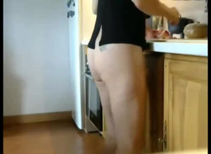 Long legged mature  cooking with naked..