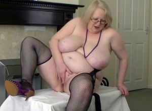 Tugging Grandmother in fishnet pantyhose