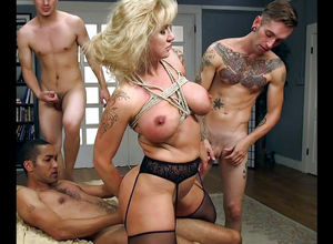 Trussed up big-titted mature gets dual..