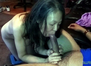 Chinese slutwife measuring hard-on at..