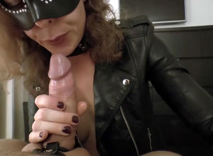 Mature dominatrix in the mask inhaling..