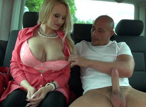 Mature blond with firm boobs gags on..